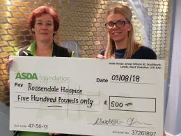 Asda colleague presenting the Hospice with a £500 cheque