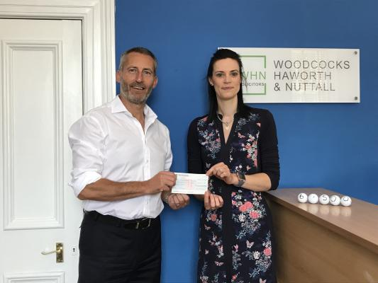 Woodcock Haworth & Nuttall presenting a cheque for six and a half thousand pound