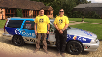 Darren McGuiness stood with the car he will do a charity rally in
