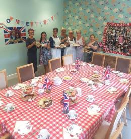Photo off the table set up for the tea party with staff and volunteers