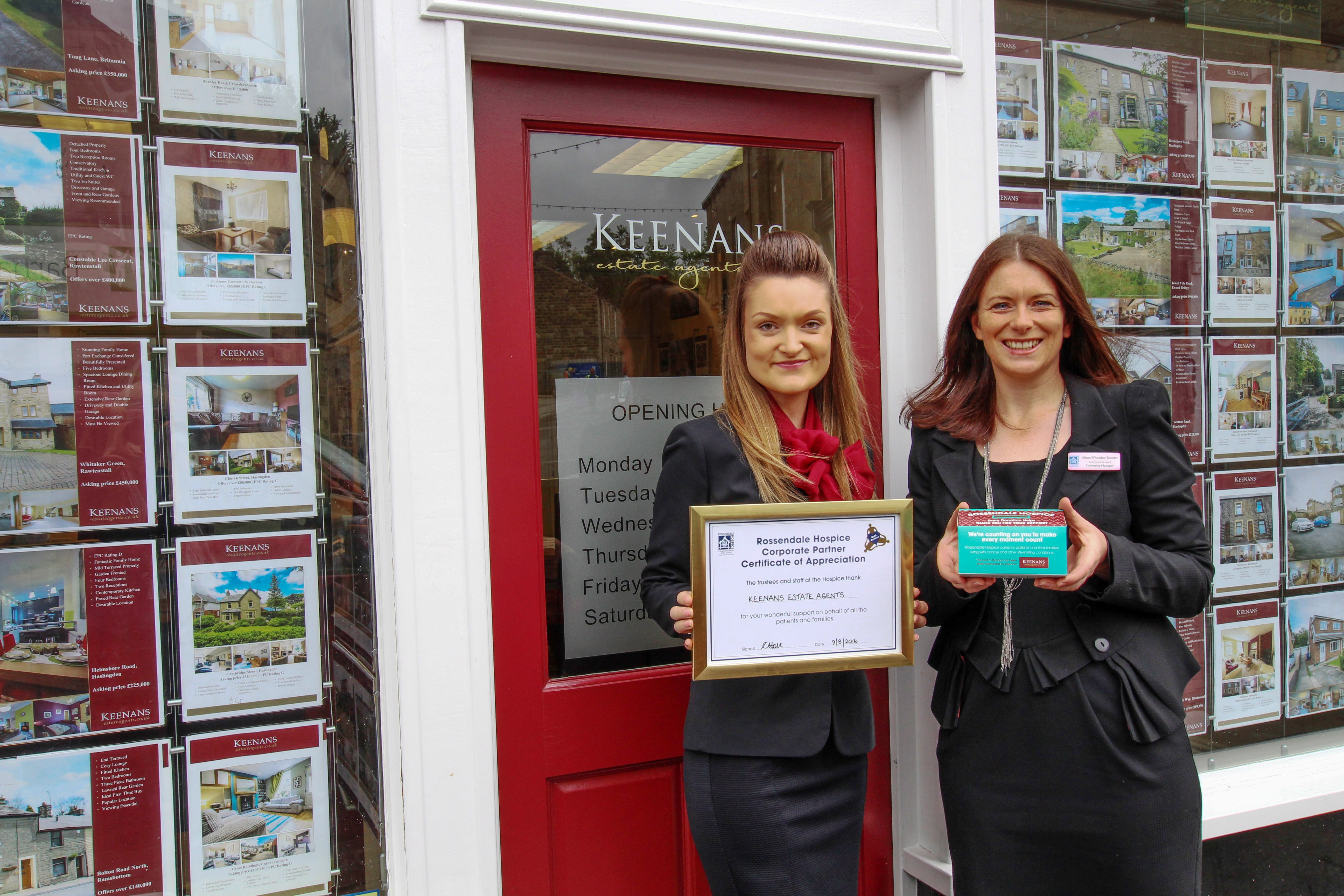 Keenans Estate Agents in front of shop