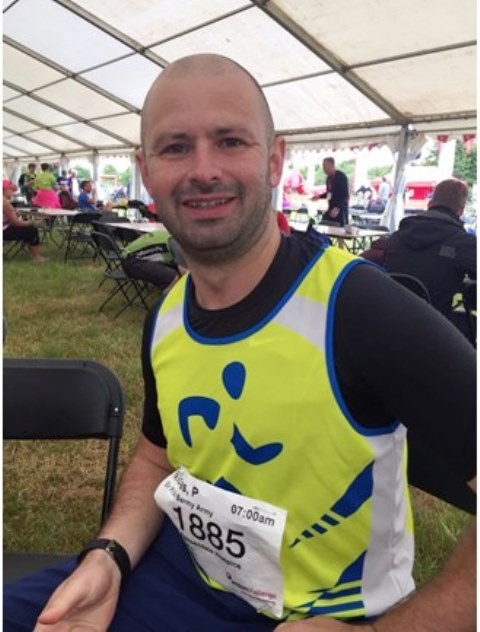 picture of Nick Pilkington in a Hospice running vest