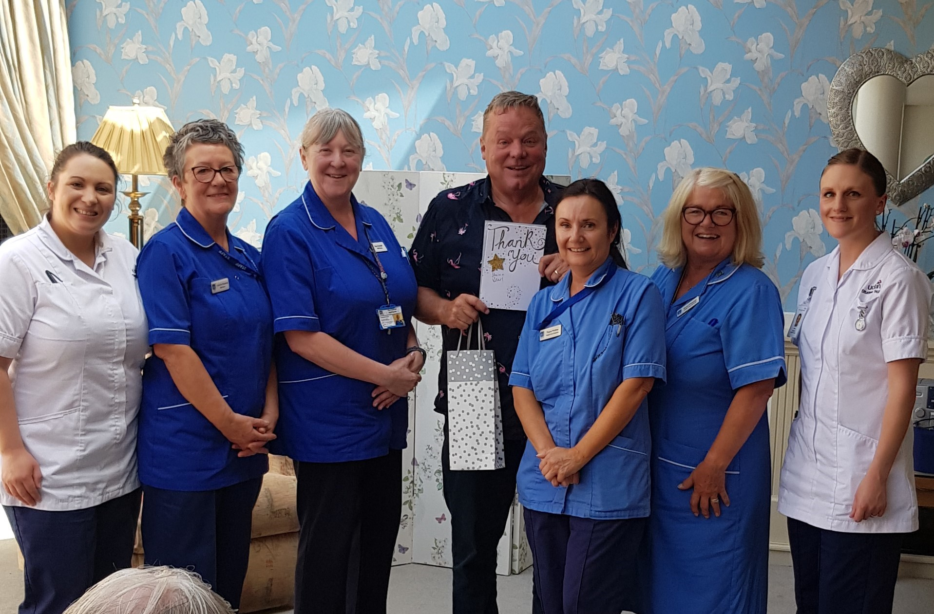 picture of Ted Robbins with some of our nursing staff