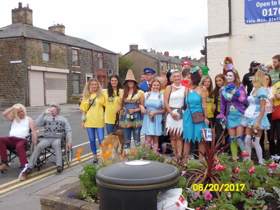 The Green Squirrel customers dressed in fancy dress costumes to do the 3 legged race
